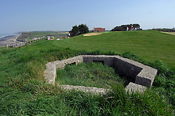 "NORMANDY, FRANCE - MAY-01-2007 - Omaha Beach Golf Club - Course: La Mer (The Sea) - Hole 6 - 469 yards - Par 4. A  German ""Pill Box"" bunker at hole 6 on La Mer course. (Photo © Jock Fistick)"