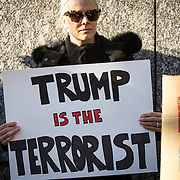 TOKYO, JAPAN - JANUARY 31 : A woman hold a placard to protest against U.S President Donald Trump's immigration ban and security agendas near US embassy in Tokyo, Japan on Tuesday, January 31, 2017. U.S. President Trump issued a executive order banning seven Muslim nations, Iraq, Syria, Iran, Sudan, Libya, Somalia or Yemen from entering the United States. (Photo by Richard Atrero de Guzman/NUR Photo)