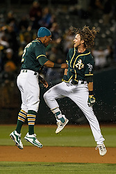 OAKLAND, CA - JULY 19:  Josh Reddick #22 of the Oakland Athletics is congratulated by Khris Davis #2 after hitting a walk off single against the Houston Astros during the tenth inning at the Oakland Coliseum on July 19, 2016 in Oakland, California. The Oakland Athletics defeated the Houston Astros 4-3 in 10 innings. (Photo by Jason O. Watson/Getty Images) *** Local Caption *** Josh Reddick; Khris Davis