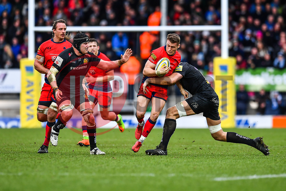 Jamie Shillcock of Worcester Warriors is tackled by Jonny Hill of Exeter Chiefs - Mandatory by-line: Craig Thomas/JMP - 10/02/2018 - RUGBY - Sandy Park Stadium - Exeter, England - Exeter Chiefs v Worcester Warriors - Aviva Premiership