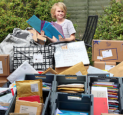 © Licensed to UK  News in  Pictures.Portsmouth,Hampshire Thursday 13th July 2017 Pictured. Mum Lisa  and Brett Jackson, with their Son Ben surround by just some of the card that people have sent after an on line appeal went viral ©UKNIP. Photo credit:UKNIP