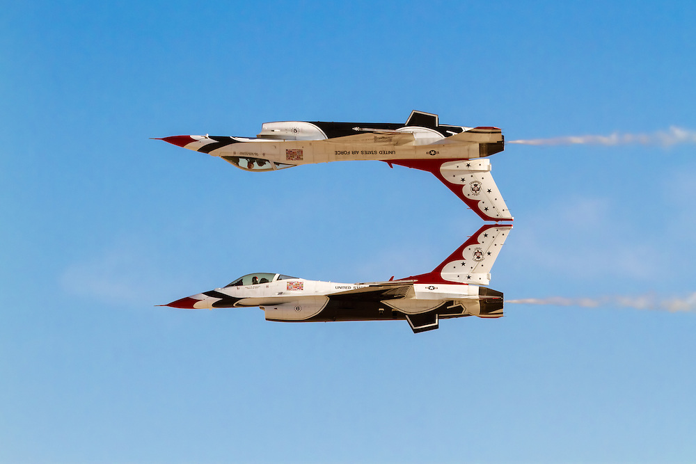Thunderbirds 5 & 6 perform the 'Calypso Pass'.  The Thunderbirds are the Air Demonstration Squadron for the United States Air Force. If you look closely, you can see the number '5' has been painted upside down so that it appears correct when the aircraft is inverted.