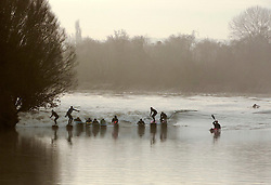 © Licensed to London News Pictures.  20/02/2015. Gloucestershire, UK.  Surfers and kayakers ride the Severn Bore on a misty morning at Newnham and Minsterworth.  The alignment of the sun and moon creating high tides led to a prediction for the biggest wave for 19 years.  Photo credit : Simon Chapman/LNP