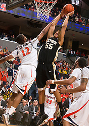 Virginia forward Jamil Tucker (12) disrupts a dunk attempt by Wake Forest center Tony Woods (55).  The Virginia Cavaliers fell to the #13 ranked Wake Forest Demon Deacons 70-60 at the John Paul Jones Arena on the Grounds of the University of Virginia in Charlottesville, VA on February 28, 2009.