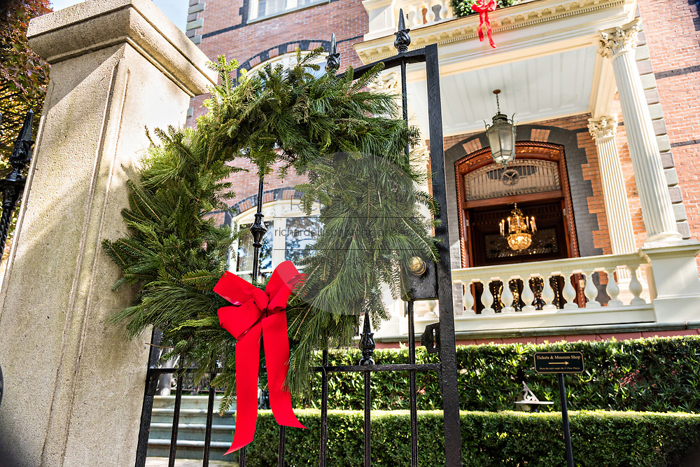 A Christmas wreath on the gate of the Calhoun Mansion on Meeting Street in Charleston, SC.
