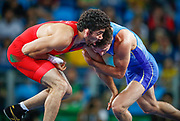 Gold medalist Soslan Ramonov from Russia (blue) and silver medlaist Toghrul Asgarov from Azerbaijan (red) in action during the men's Freestyle 65kg gold medal bout of the Rio 2016 Olympic Games Wrestling events at the Carioca Arena 2 in the Olympic Park in Rio de Janeiro, Brazil, 21 August 2016.