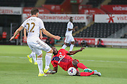 defender Femi Illesami and defender Angel Rangel tangle for the ball during the Capital One Cup match between Swansea City and York City at the Liberty Stadium, Swansea, Wales on 25 August 2015. Photo by Simon Davies.