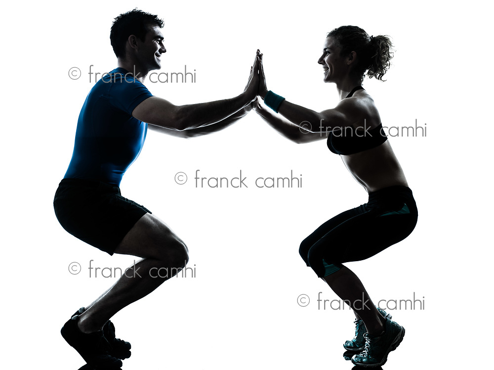 one caucasian couple man woman personal trainer coach exercising squatts silhouette studio isolated on white background