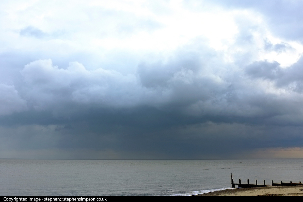 © Licensed to London News Pictures. 29/11/2013. Southwold, UK Rain clouds form over the sea at  Southwold, Suffolk today, 29 November 2013. Photo credit : Stephen Simpson/LNP