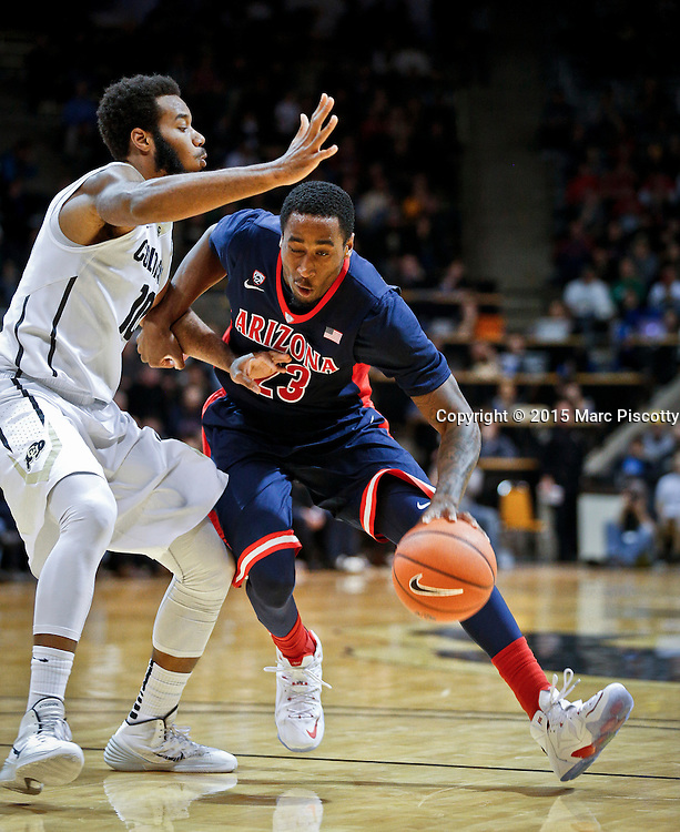 SHOT 2/26/15 9:23:36 PM - Arizona's Rondae Hollis-Jefferson #23 drives the lane in front of Colorado's Tre'Shaun Fletcher #10 during their regular season Pac-12 basketball game at the Coors Events Center in Boulder, Co. Arizona won the game 82-54.<br /> (Photo by Marc Piscotty / &copy; 2015)