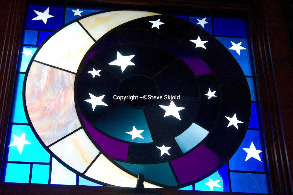Creation stain glass window of the moon and stars. First Lutheran Church Fergus Falls Minnesota USA