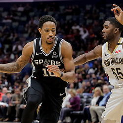 Nov 19, 2018; New Orleans, LA, USA; San Antonio Spurs guard DeMar DeRozan (10) drives past New Orleans Pelicans guard E'Twaun Moore (55) during the second half at the Smoothie King Center. Mandatory Credit: Derick E. Hingle-USA TODAY Sports