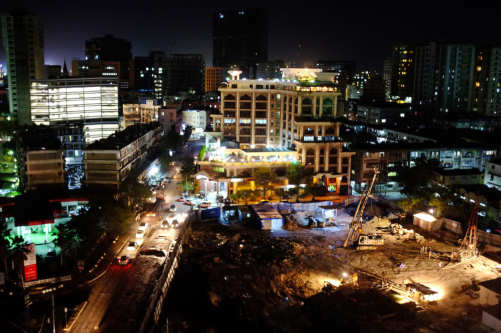 DAR ES SALAAM, TANZANIA - 13-08-22 -  Downtown Dar es Salaam at night on August 22. A new high-rise is being constructed at right. Dar es Salaam is one of Africa's fastest growing cities. Photo by Daniel Hayduk