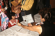 A young India girl is given an American flag during an immigration naturalization ceremony November 12, 1996 in Washington, DC.