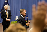 Members of the audience raise their hands to be called on as Senator Lindsay Graham (R-SC) answers a question during a health care town hall meeting and fellow Senator John McCain (R-AZ)  looks on September 14, 2009 at the Citadel in Charleston, SC.