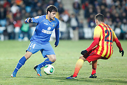 16.01.2014, Coliseum Alfonso Perez, Getafe, ESP, Copa del Rey, FC Getafe vs FC Barcelona, Achtelfinale, Rueckspiel, im Bild Getafe´s Pedro Leon (L) and Barcelona´s Adriano // Getafe´s Pedro Leon (L) and Barcelona´s Adriano during the last sixteen 2nd leg match of Spanish Copa del Rey between Getafe CF and Barcelona FC at the Coliseum Alfonso Perez in Getafe, Spain on 2014/01/16. EXPA Pictures © 2014, PhotoCredit: EXPA/ Alterphotos/ Victor Blanco<br /> <br /> *****ATTENTION - OUT of ESP, SUI*****