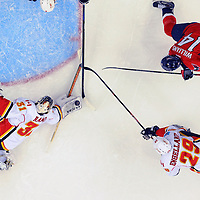 13 November 2015:  Calgary Flames goalie Karri Ramo (31) makes a save on a shot by Washington Capitals right wing Justin Williams (14) at the Verizon Center in Washington, D.C. where the Calgary Flames defeated the Washington Capitals, 3-2 in overtime.  (Photograph by Mark Goldman - Goldminephotos)