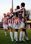 Cheltenham players celebrate Omari Sterling-Jones goal during the Sky Bet League 2 match between Cheltenham Town and Portsmouth at Whaddon Road, Cheltenham, England on 20 December 2014. Photo by Alan Franklin.