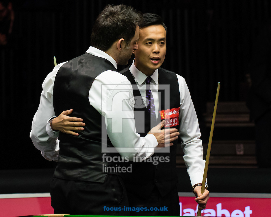 Ronnie O'Sullivan commiserates with Marco Fu with after his 6-4 victory  during the semi-finals of the Dafabet Snooker Masters 2017 at Alexandra Palace, London<br /> Picture by Mark Chappell/Focus Images Ltd +44 77927 63340<br /> 21/01/2017