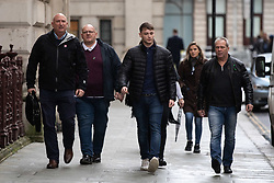 © Licensed to London News Pictures. 17/12/2019. London, UK. Tim Dunn (2L, father of Harry Dunn,) Bruce Charles (right, step father of Harry Dunn) and family spokesperson Radd Seiger (left) arrive at the Foreign and Commonwealth Office in Westminster, London, for a meeting with Foreign Secretary Dominic Raab. Harry Dunn was killed when his motorbike crashed into a car outside RAF Croughton in Northamptonshire on August 27. Photo credit : Tom Nicholson/LNP