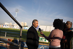 Bnei Sakhnin team owner Mazen Ghanayem, doing an interview during half time of a qualifying game, Ramat Gan, Israel, Jan. 31, 2006. The team has a mixture of Israeli-Arab, Israeli, and foreign players. Football star Abbas Suan, himself an Israeli-Arab, who still faces criticism and racism resulting from the unsettled conflict between the Israelis and Palestinians.