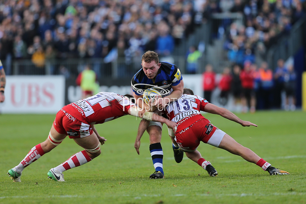 Bath scrum half Kahn Fotuali' I (9) is blocked by  Gloucester back row Lewis Ludlow (7)   and Gloucester centre Henry Trinder (13) and \ during the Aviva Premiership match between Bath Rugby and Gloucester Rugby at the Recreation Ground, Bath, United Kingdom on 29 October 2017. Photo by Gary Learmonth.