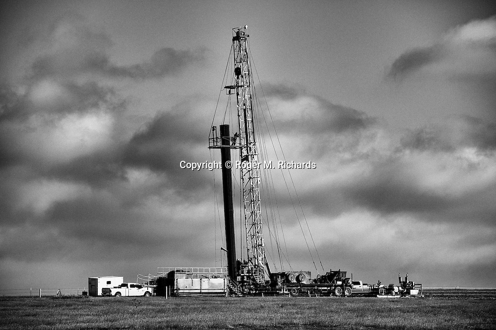 A drilling rig operating in an oil and gas field in Weld County, Colorado. It is one of scores of rigs that travel to different locations to drill into the shale rock, soon followed by pumps that inject a toxic brew of water and chemicals for hydraulic extraction or 'fracking' of oil and gas. A boom in drilling across the American West has led to pollution and environmental problems in what were once pristine lands. Photograph by Roger M. Richards