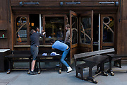 With a further 89 UK covid victims in the last 24hrs, bringing the total victims to 43,995 during the Coronavirus pandemic, pubs, restaurants and hairdressers will be able to reopen on 4th July, providing they adhere to COVID Secure guidelines. Repair and refurbishment workmen install a window at a bar on Old Compton Street in Soho, on 2nd July 2020, in London, England.