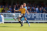 AFC Wimbledon attacker Marcus Forss (15) battles for possession with Bristol Rovers defender Tony Craig (5) during the EFL Sky Bet League 1 match between AFC Wimbledon and Bristol Rovers at the Cherry Red Records Stadium, Kingston, England on 21 September 2019.