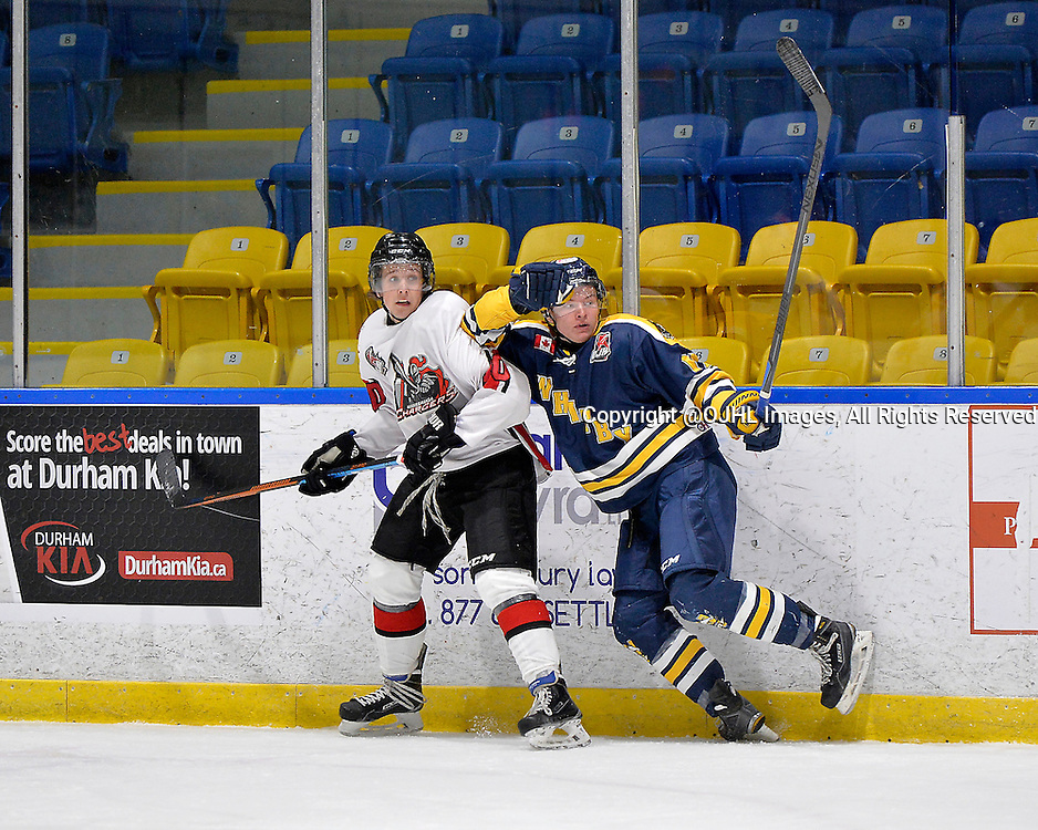 WHITBY, ON - Oct 18, 2015 : Ontario Junior Hockey League game action between Mississauga and Whitby, Kyler Matthews #10 of the Mississauga Chargers and Cole Brooks #17 of the Whitby Fury battle along the boards during the first period.<br /> (Photo by Shawn Muir / OJHL Images)