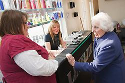 Carer taking old lady to hairdresser's.