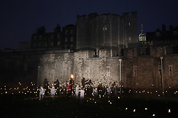 © Licensed to London News Pictures. 04/11/2018. London, UK.Thousands of flames illuminate the moat of The Tower of London in an installation entitled 'Beyond the Deepening Shadow: The Tower Remembers'. This public act of remembrance for the lives of the fallen, honouring their sacrifice will run for eight nights, leading up to and including the Centenary Armistice Day 2018. The evolving installation will unfold each evening over the course of four hours, with the Tower moat gradually illuminated by individual flames. A specially-commissioned sound installation 'a sonic exploration of the shifting tide of political alliances, friendship, love and loss in war' will be played. At the centre of the sound installation lies a new choral work, with words from war poet Mary Borden's Sonnets to a Soldier. Photo credit: Peter Macdiarmid/LNP
