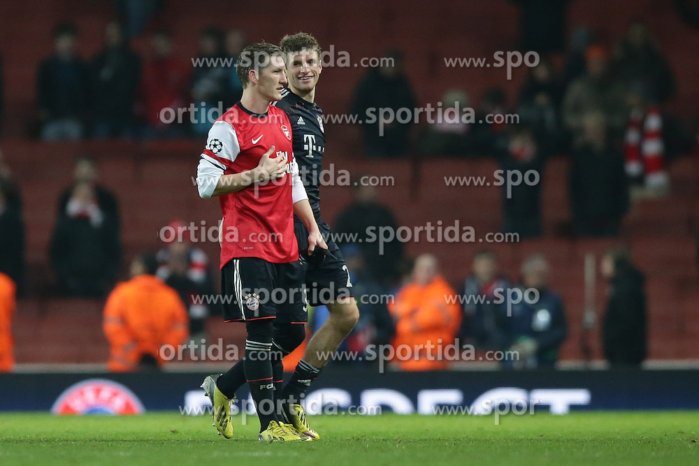 19.02.2013, Emirates Stadion, London, ENG, UEFA Champions League, FC Arsenal vs FC Bayern Muenchen, Achtelfinale Hinspiel, im Bild, Bastian SCHWEINSTEIGER (FC Bayern Muenchen - 31) im Trikot von Per MERTESACKER (FC Arsenal London - 4) - rechts Thomas MUELLER (FC Bayern Muenchen - 25) // during the UEFA Champions League last sixteen first leg match between Arsenal FC and FC Bayern Munich at the Emirates Stadium, London, Great Britain on 2013/02/19. EXPA Pictures © 2013, PhotoCredit: EXPA/ Eibner/ Gerry Schmit..***** ATTENTION - OUT OF GER *****