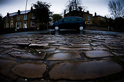 © Licensed to London News Pictures. 29/04/2015. Bradford, West Yorkshire. Rain on a cobbled street in Bradford. Photo credit : Paul Thompson/LNP