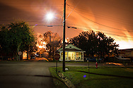 "December 19th, 2013, Norco Louisiana, A flare from the Shell Refinery illuminates the sky. Norco is part of a corridor between Baton Rouge and New Orleans known to those in Industry and the 'petrochemical corridor and to locals as ""cancer alley""."