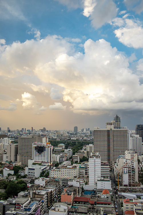 The skyline of Bangkok showing a heavy concentration of  apartment buildings and hotels. The image was taken just after dawn.