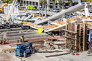 Miami-Dade first responders arrive at the debris created by the FIU bridge that collapsed Thursday afternoon leaving six people dead on March 15, 2018.
