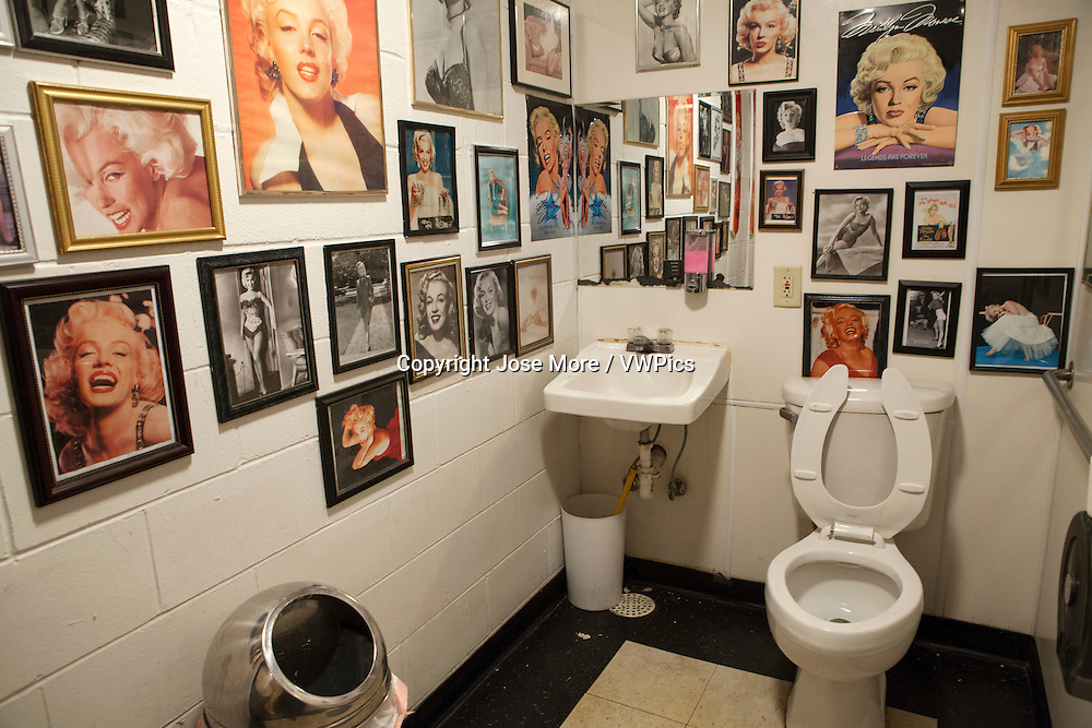 Mens bathroom at the Polk=-a-Dot drive in decorated with photographs of Marilyn Monroe. Historic U.S. Route 66 starts in Chicago traveling through 6 states and ending in Santa Monica, California.