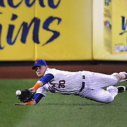 Michael Conforto, New York Mets, makes a fina catch at left field to dismiss A.J. Pierzynski, Atlanta Braves, in the top of the eigth inning during the New York Mets Vs Atlanta Braves MLB regular season baseball game at Citi Field, Queens, New York. USA. 22nd September 2015. Photo Tim Clayton