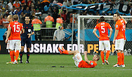 Wesley Sneijder and team mates of Netherlands show dejection after loosing the penalty shoot out during the 2014 FIFA World Cup match at Arena Corinthians, Sao Paulo<br /> Picture by Andrew Tobin/Focus Images Ltd +44 7710 761829<br /> 09/07/2014