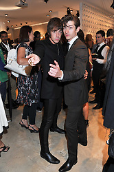 Left to right, MILES KANE and singer ALEX TURNER of the Artic Monkey at the launch of the Spencer Hart Flagship store, Brook Steet, London on 13th September 2011.
