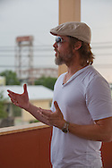 "Brad Pitt wearing a beard and a berret on the deck of one of the homes in  his ""Make it Right"" housing project in New Orleans Lower 9th Ward that was devestated by Hurricane Katrina."