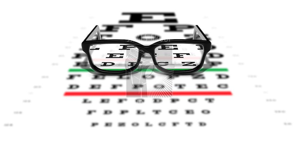 Prescription glasses sitting on an eye test chart