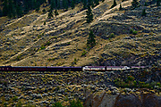 Rocky Mountaineer train view across valley,  Canadian Cascades, Canadian Pacific freight train