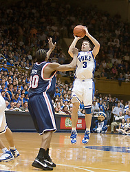 Duke guard Greg Paulus (3) shoots a three pointer against UVA.  The Duke Blue Devils defeated the Virginia Cavaliers 87-65 in men's basketball at Cameron Indoor Stadium on the campus of Duke University in Durham, NC on January 13, 2008.