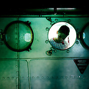 A young boy inspects the engine room on the TSS Earnslaw, the 100 year old vintage coal fired passenger steam ship which sails on Lake Wakatipu, Queenstown, New Zealand. The popular tourist attraction is celebrating it's centenary year with celebrations planned for October 2012.  Queenstown, Central Otago, New Zealand. 29th February 2012. Photo Tim Clayton