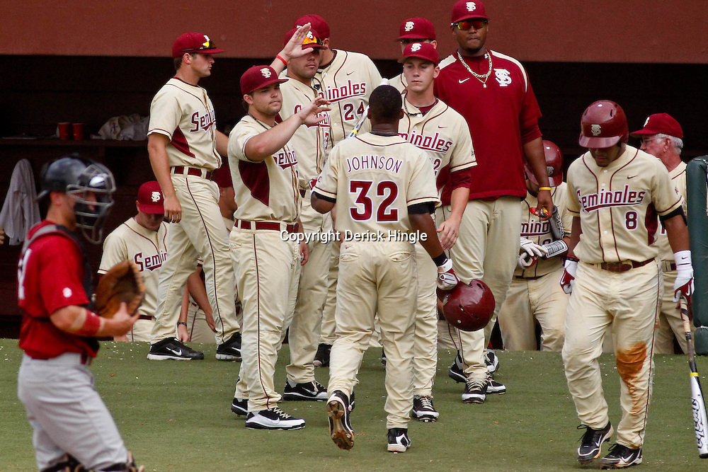 June 05, 2011; Tallahassee, FL, USA; Florida State Seminoles third baseman Sherman Johnson (32) celebrates with teammates after scoring against the Alabama Crimson Tide during the second inning of the Tallahassee regional of the 2011 NCAA baseball tournament at Dick Howser Stadium. Mandatory Credit: Derick E. Hingle