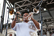 Efrem Towns of The Dirty Dozens Brass Band plays the flugelhorn and the trumpet at the same time during Artscape in Baltimore, MD on Saturday, July 20, 2013.