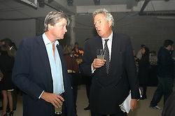 Left to right, the MARQUESS OF WORCESTER and HENRY WYNDHAM at an exhibition of work by Rolf Sachs - a unique world-renowned contemporary furniture designer, held in association with the Louisa Guinness Gallery and held at 250 Brompron Road, London on 6th October 2004.<br />