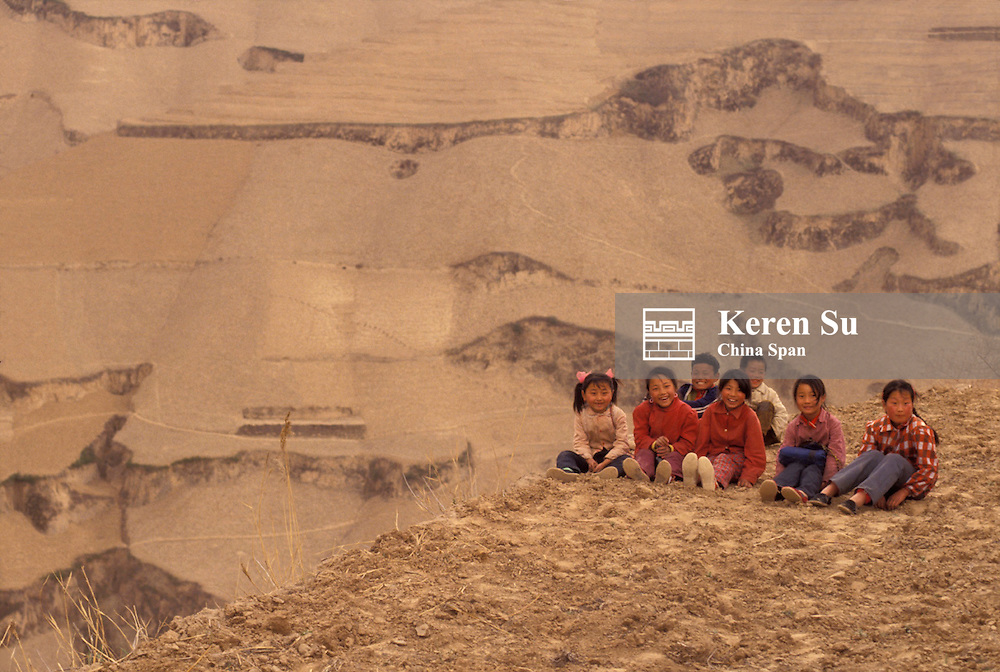 Children sitting on the Loess Plateau, Shaanxi Province, China